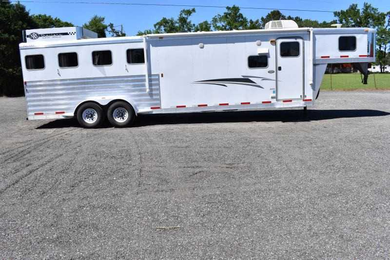 #55127 - Used 2012 Exiss 7410LQ 4 Horse Trailer  with 11' Short Wall