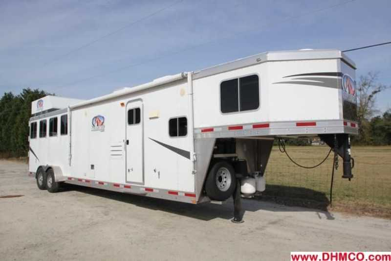 #87377 - Used 2011 Lakota 7413GLQ Charger 4 Horse Trailer with 12' Short Wall
