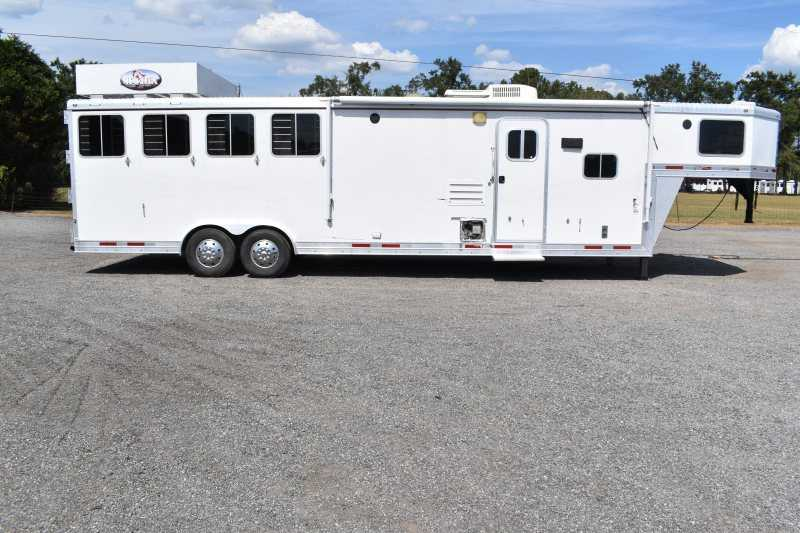 #87111 - Used 2009 Lakota 8412LQ 4 Horse Trailer  with 12' Short Wall