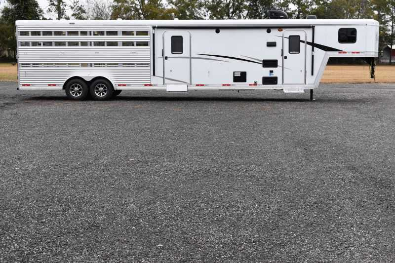 #08892 - New 2019 Bison Trail Boss 7009STLTSO Stock Trailer with 9' Short Wall